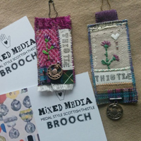 Scottish thistle medal brooches